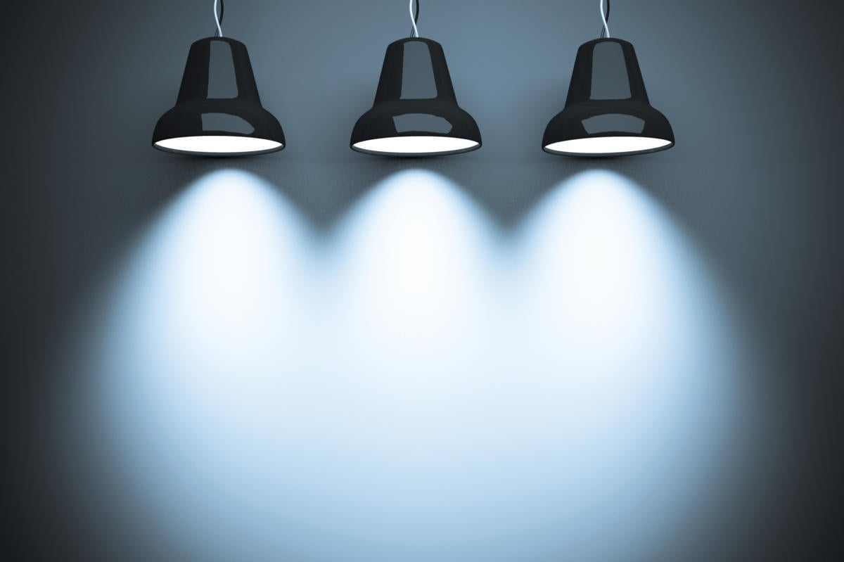 three spotlights casting lights on wall for text