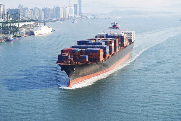 Cargo ship with shipping containers in ocean