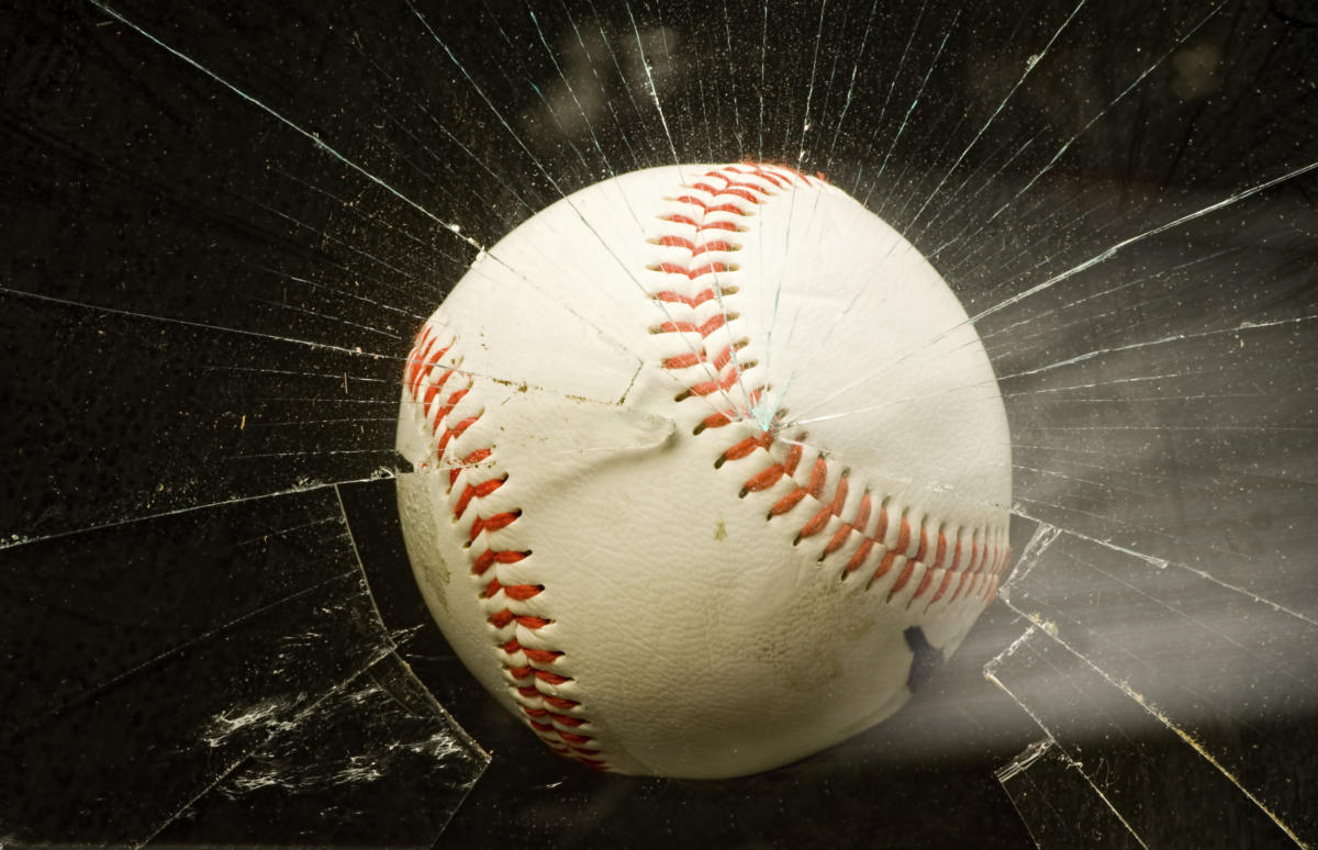 baseball breaking glass window