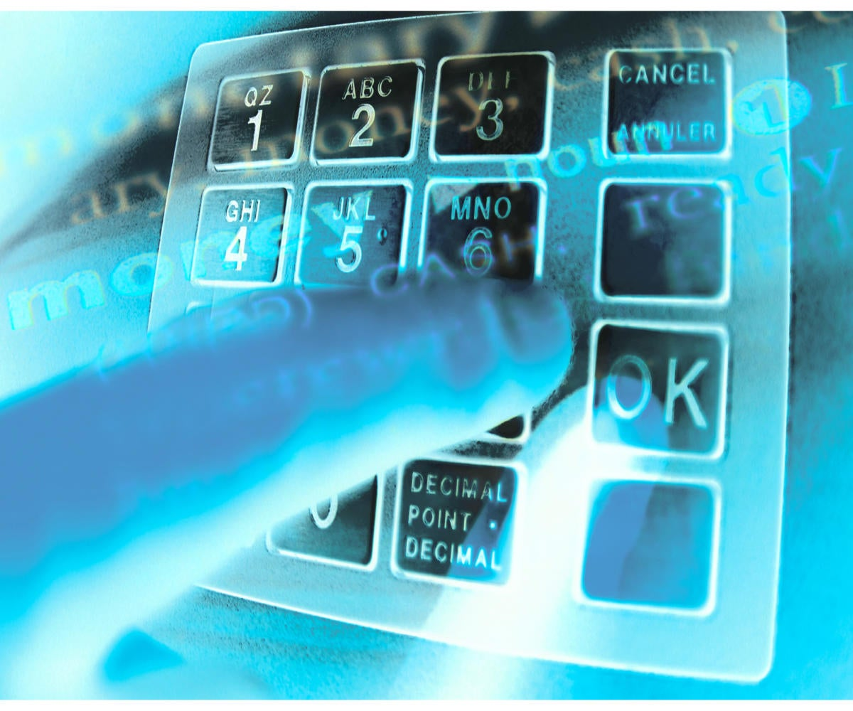 Glowing blue montage of hand keying in password at ATM