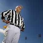 Referee shot from below on football field