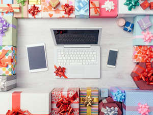 new tech devices surrounded by gifts