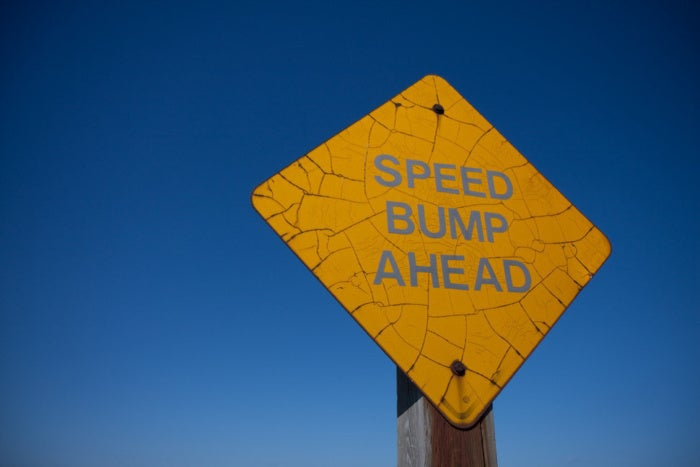 speed bump ahead sign