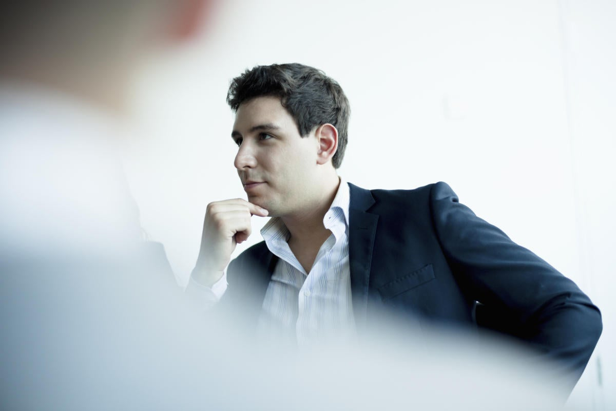 Man thinking in office meeting