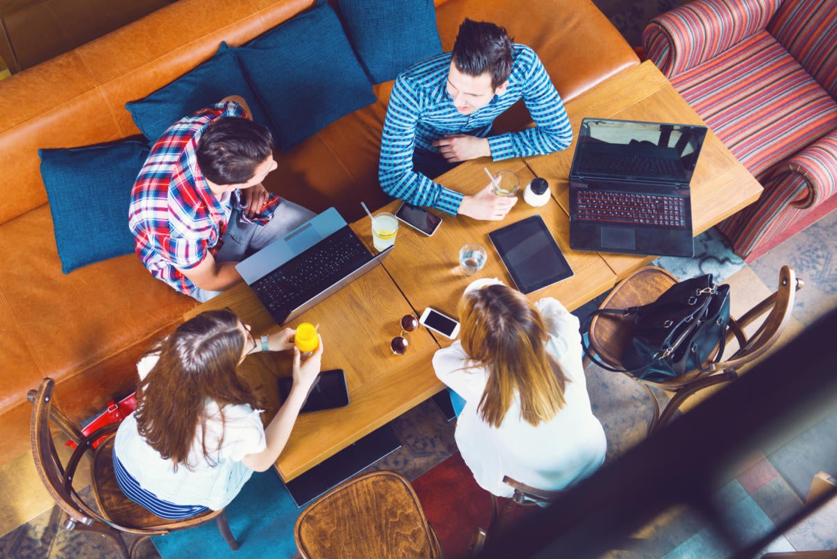 Millennials working in casual space collaborating