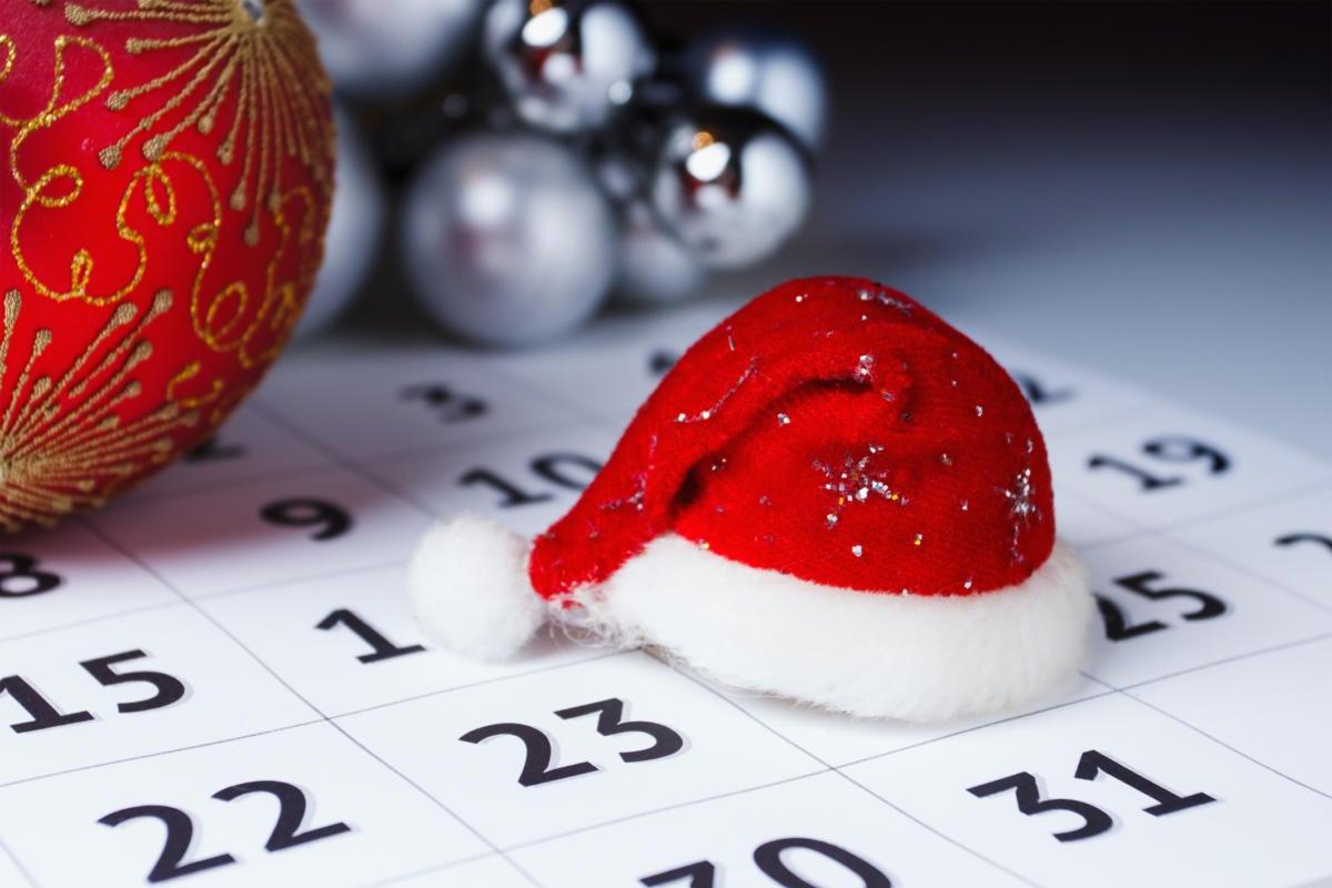 Santa hat sitting on top of calendar christmas