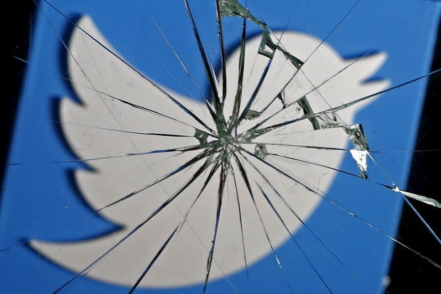 twitter logo shattered glass