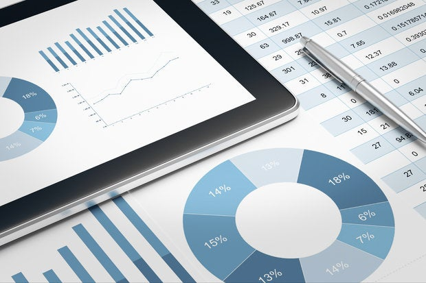digital tablet and financial report on table 000067447463 medium