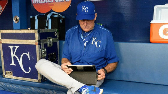 royals coach rusty kuntz uses an ipad prior to game 3 of last years american league championship se