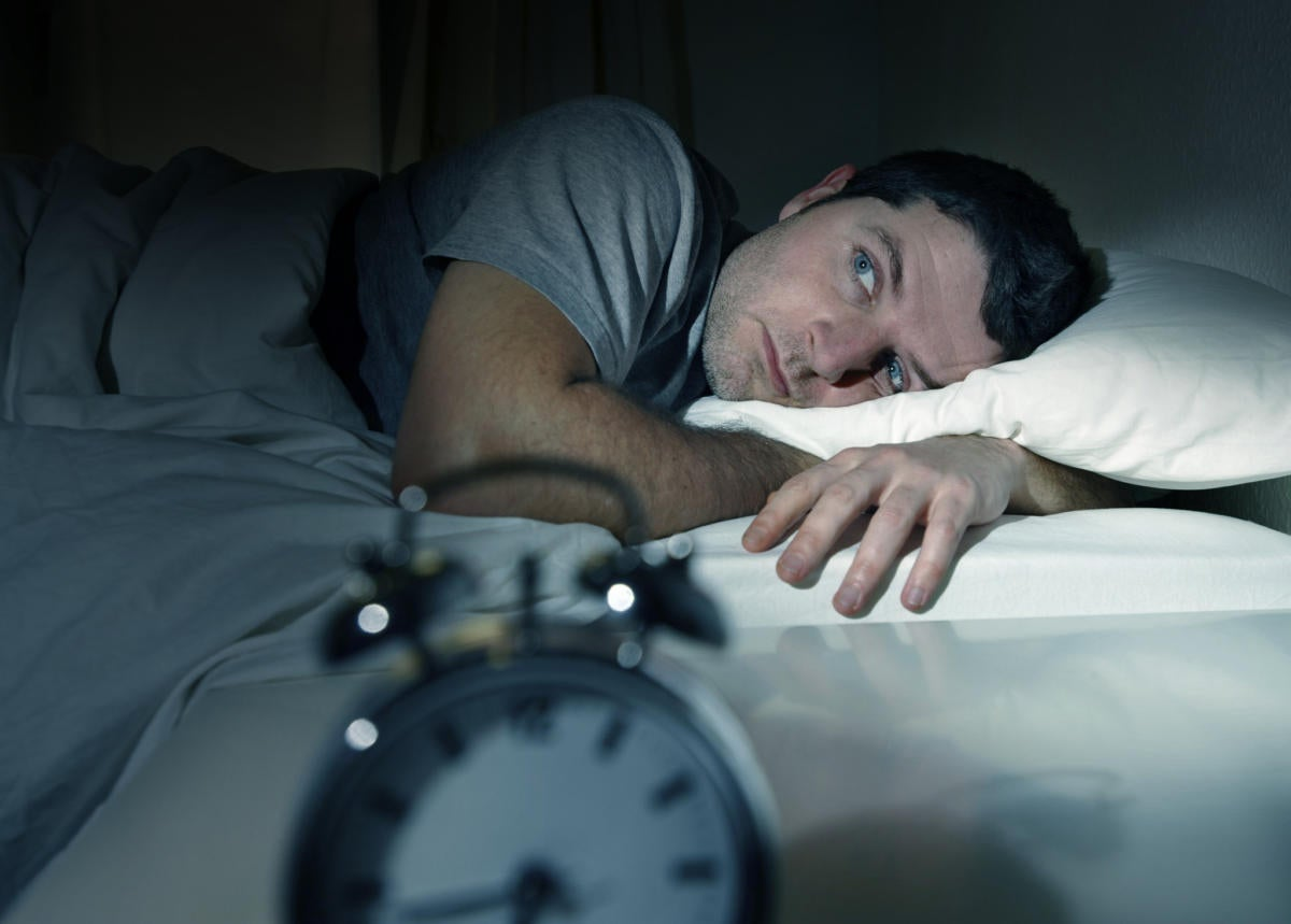 Man trying to sleep in the middle of the night