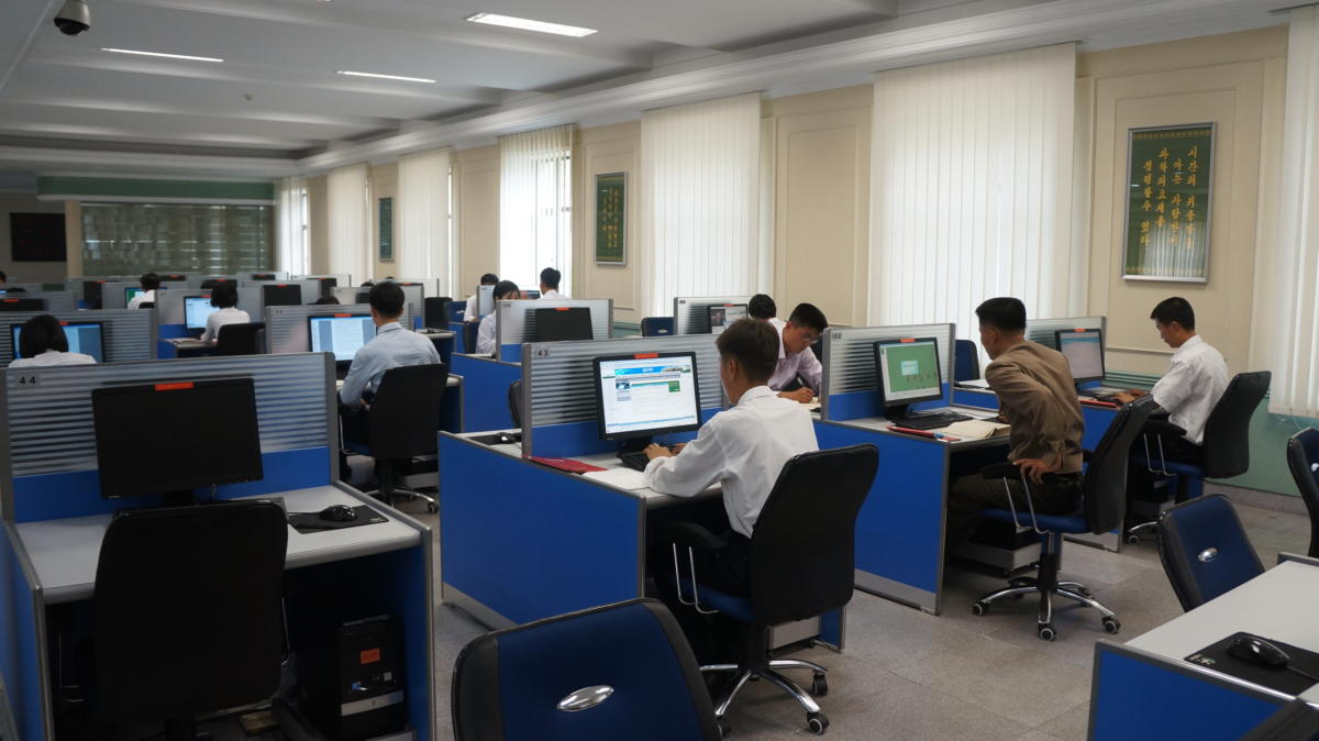 Students use computers at Kim Il Sung University, North Korea