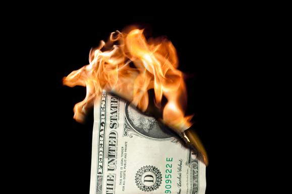 thinkstock dollar on fire primary