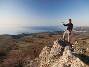 travel mountain hiker peak crest view