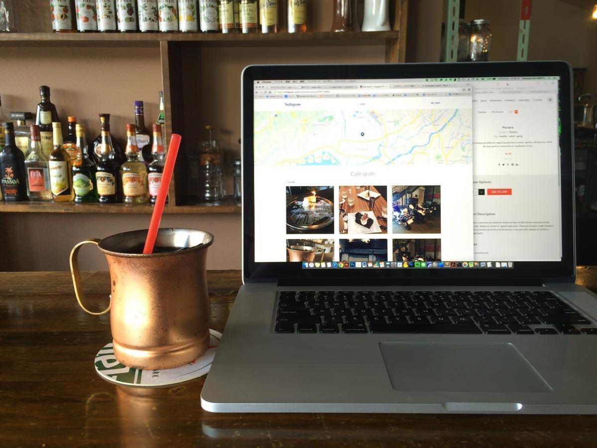 working remotely at cafe or coffee shop with laptop