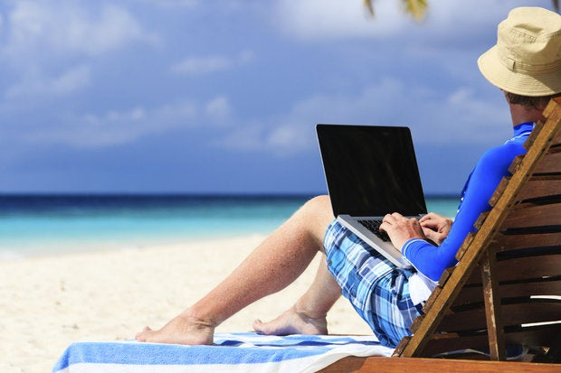 man with laptop on tropical vacation 000045135034 medium
