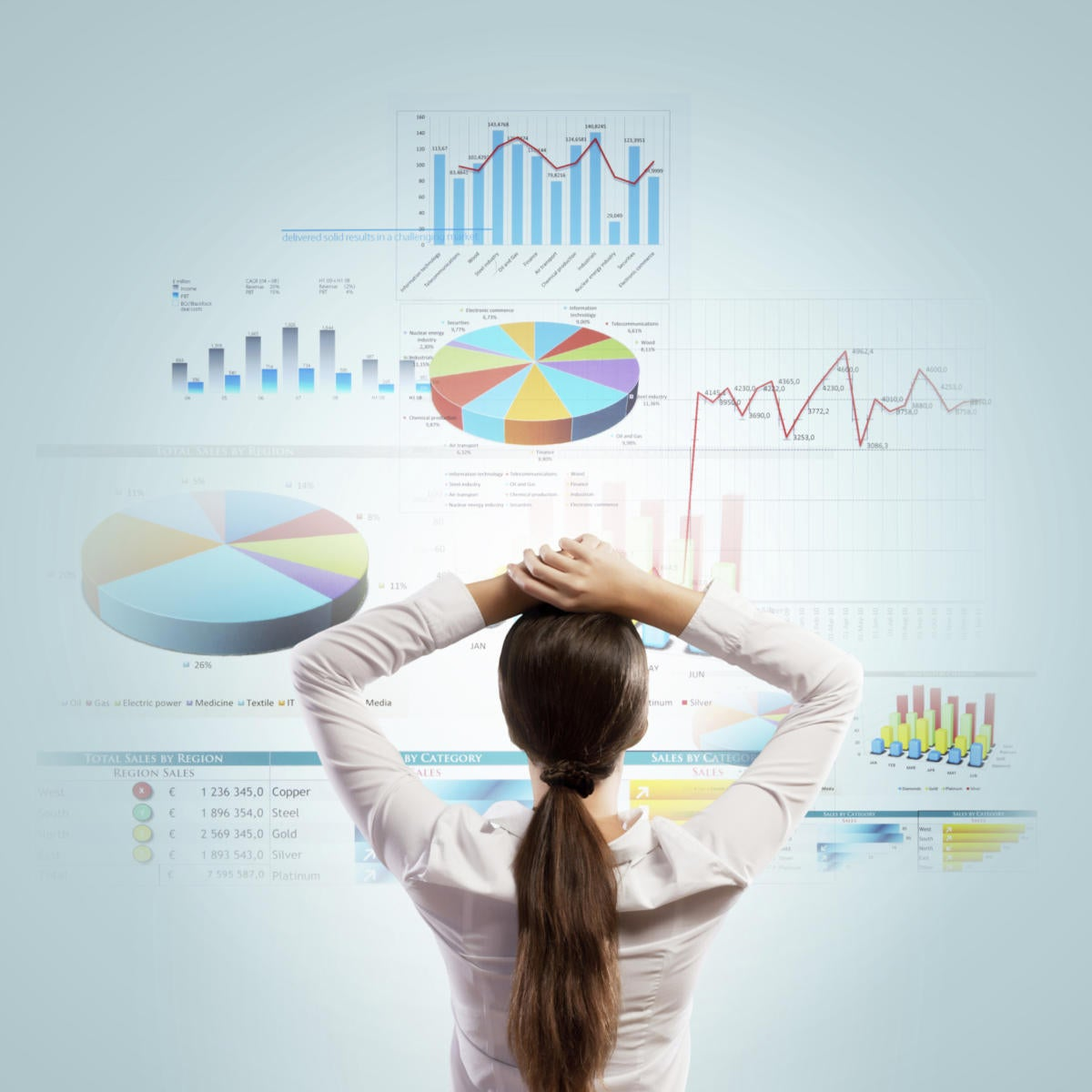 woman standing in front of data chart wall