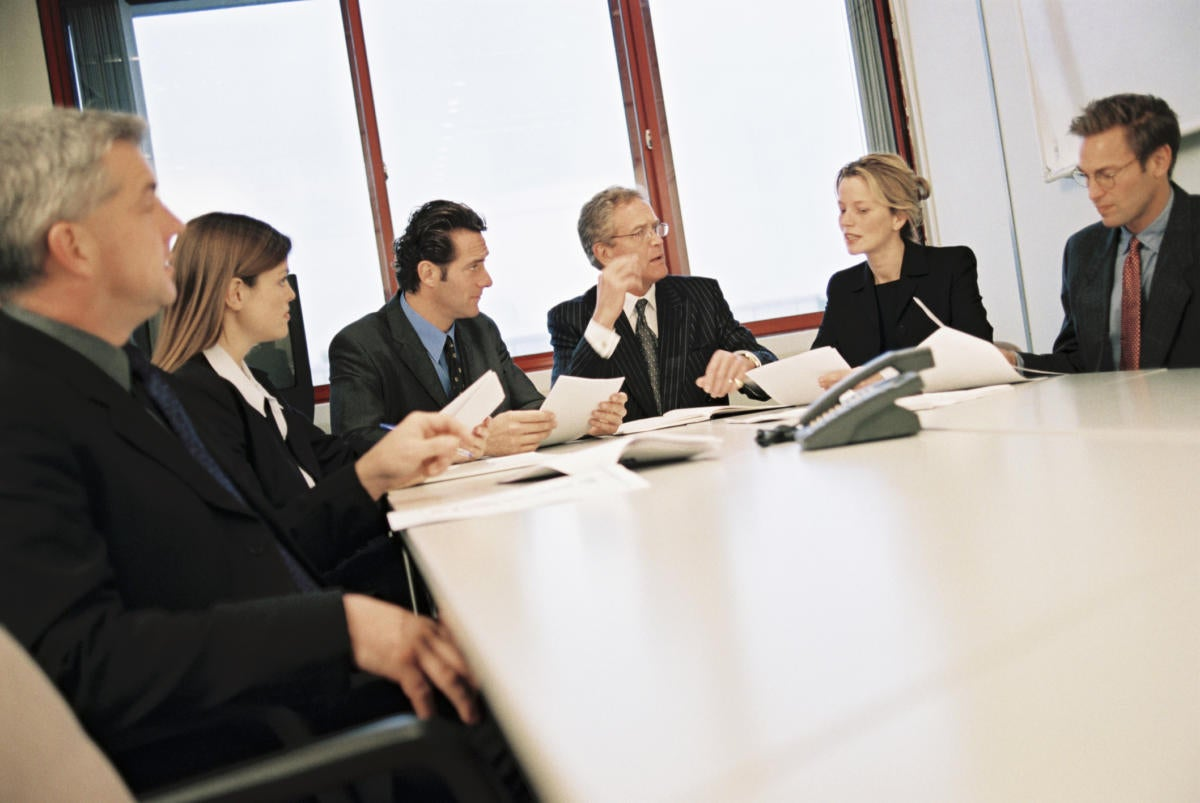 executives sitting in board room at conference table
