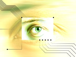 closeup of eye against computer circuitry
