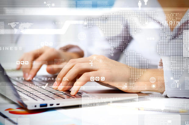 woman on computer with tech background
