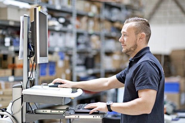 storage worker using computer 000049209142 medium