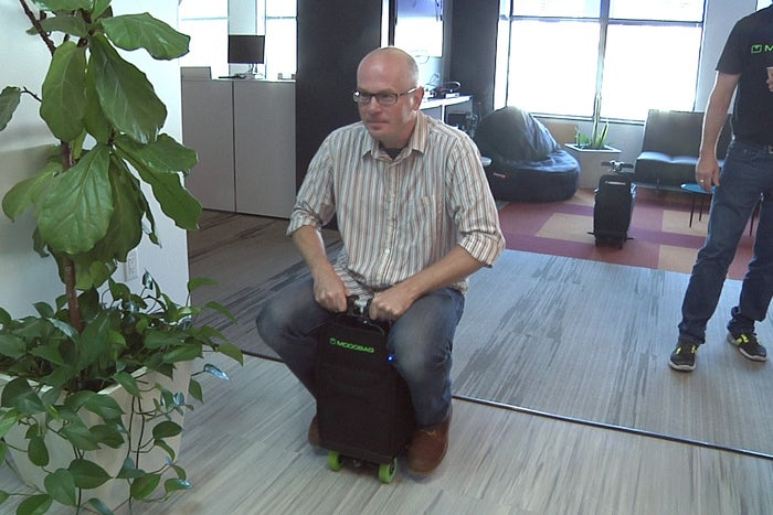 Riding the modobag the motorized carry on suitcase for Motorized ride on suitcase