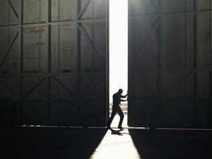 pushing open doors breakt through light idea