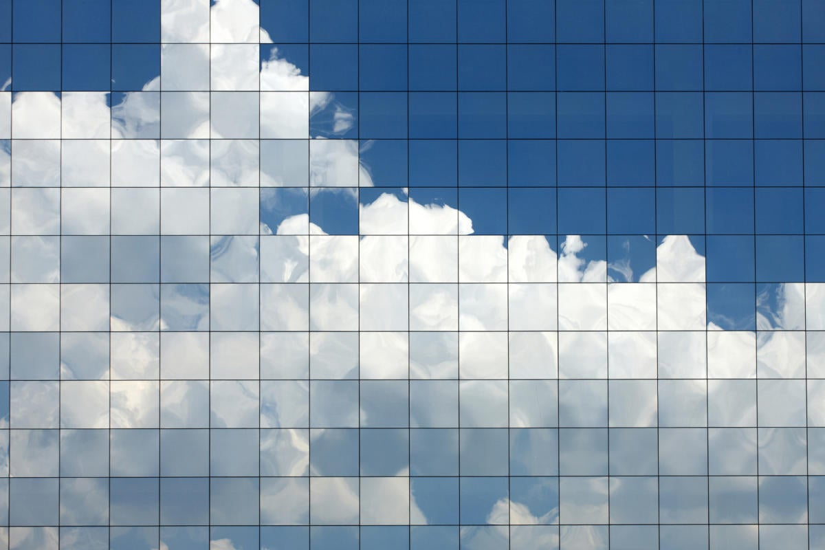 pixelated clouds reflecting on building windows