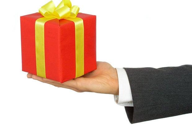 bigstock businessman s hands holding gi 253604