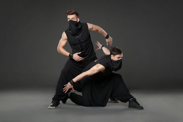 bigstock two male dancers posing in nin 136185341