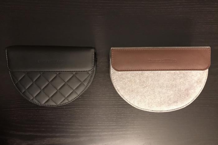 The P9's soft, leather-accented, grey Alcantara carrying case compared to the P7's.