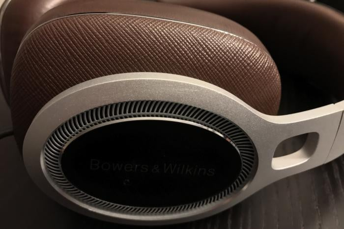 Detail view of the P9 Signature's cross hatched leather ear ups and forged aluminum arms.