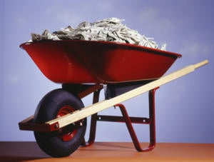 Red wheel barrow filled with money