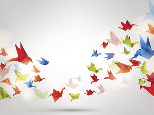 colorful origami birds in flight