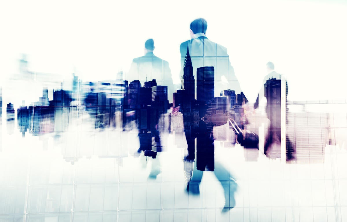 abstract image of executives walking with skyline superimposed on bodies