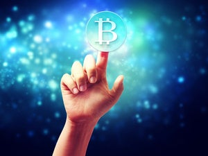 Hand pointing at bitcoin in virtual background