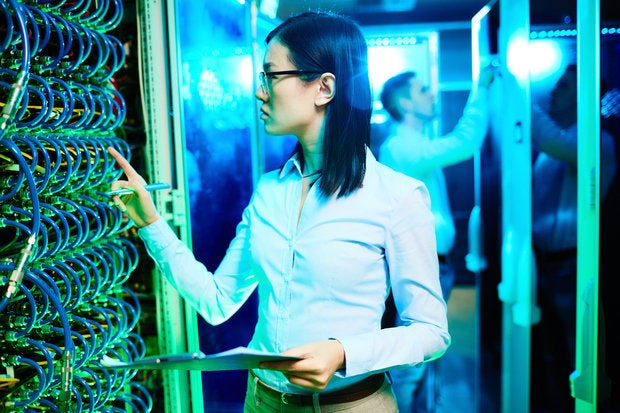 Woman working in network room