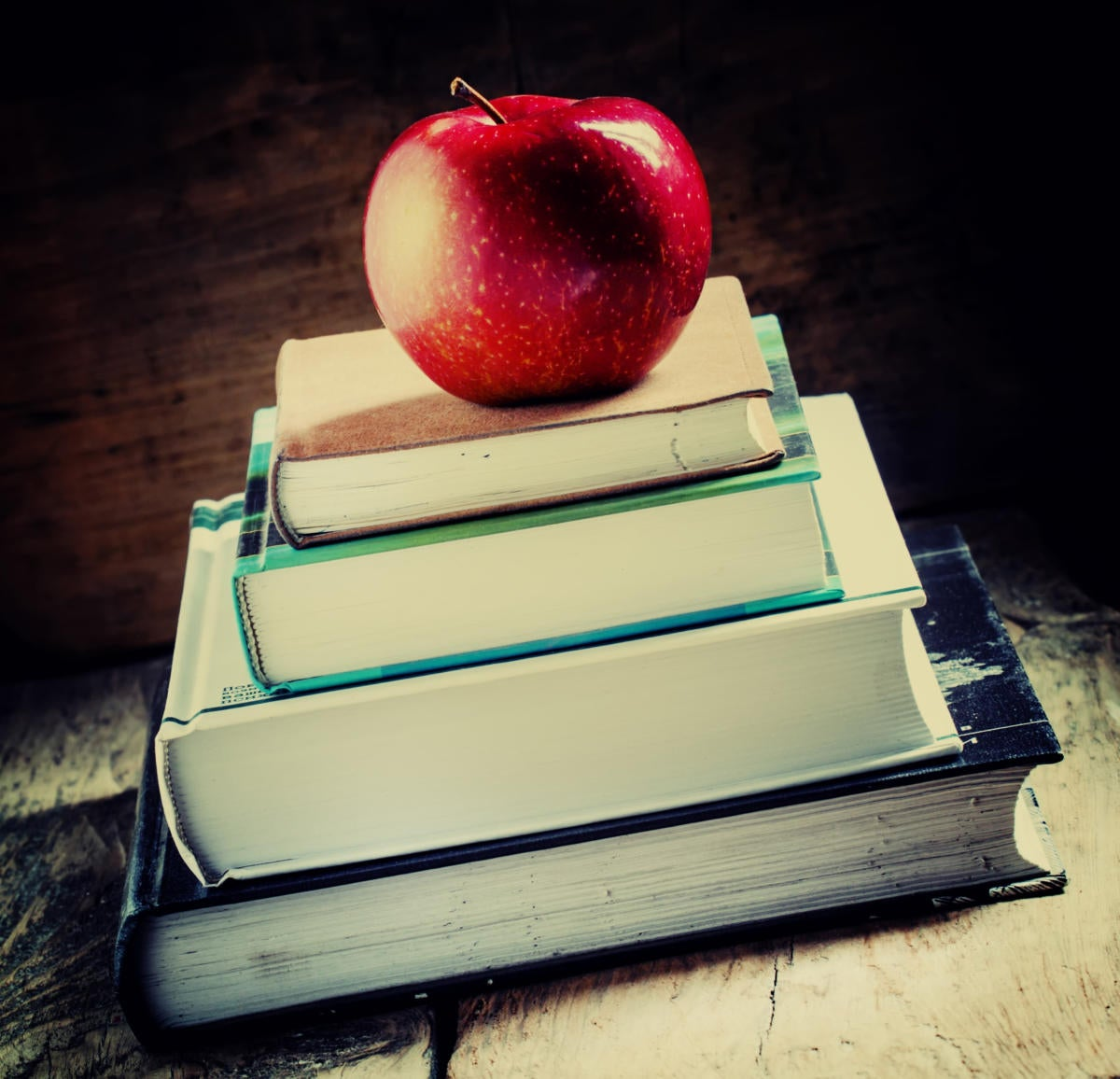 student books with apple for teacher