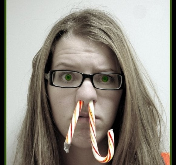 woman with candy cane in her nose