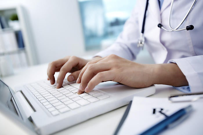 medical records laptop doctor