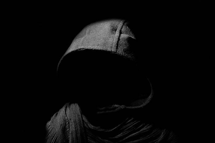 shadowy attacker hooded