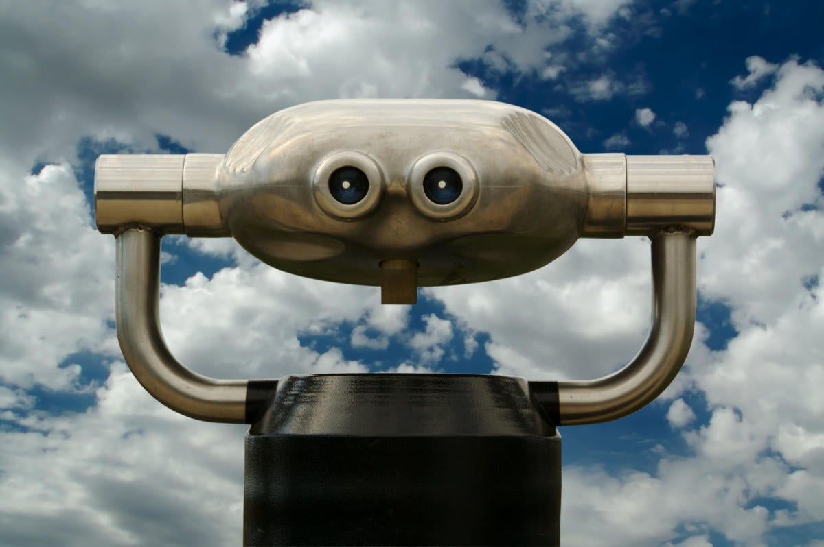 Public binoculars against cloudy sky
