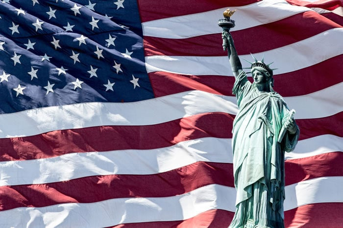 us flag and statue of liberty (public domain)