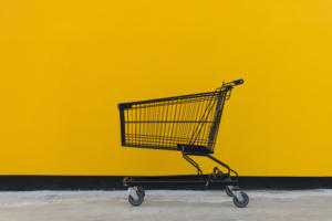 Shopping cart against yellow building