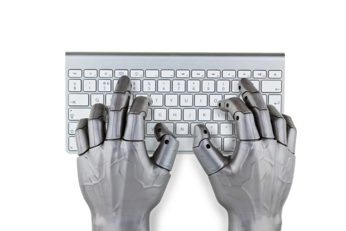 Robotic AI hands typing on computer keyboard