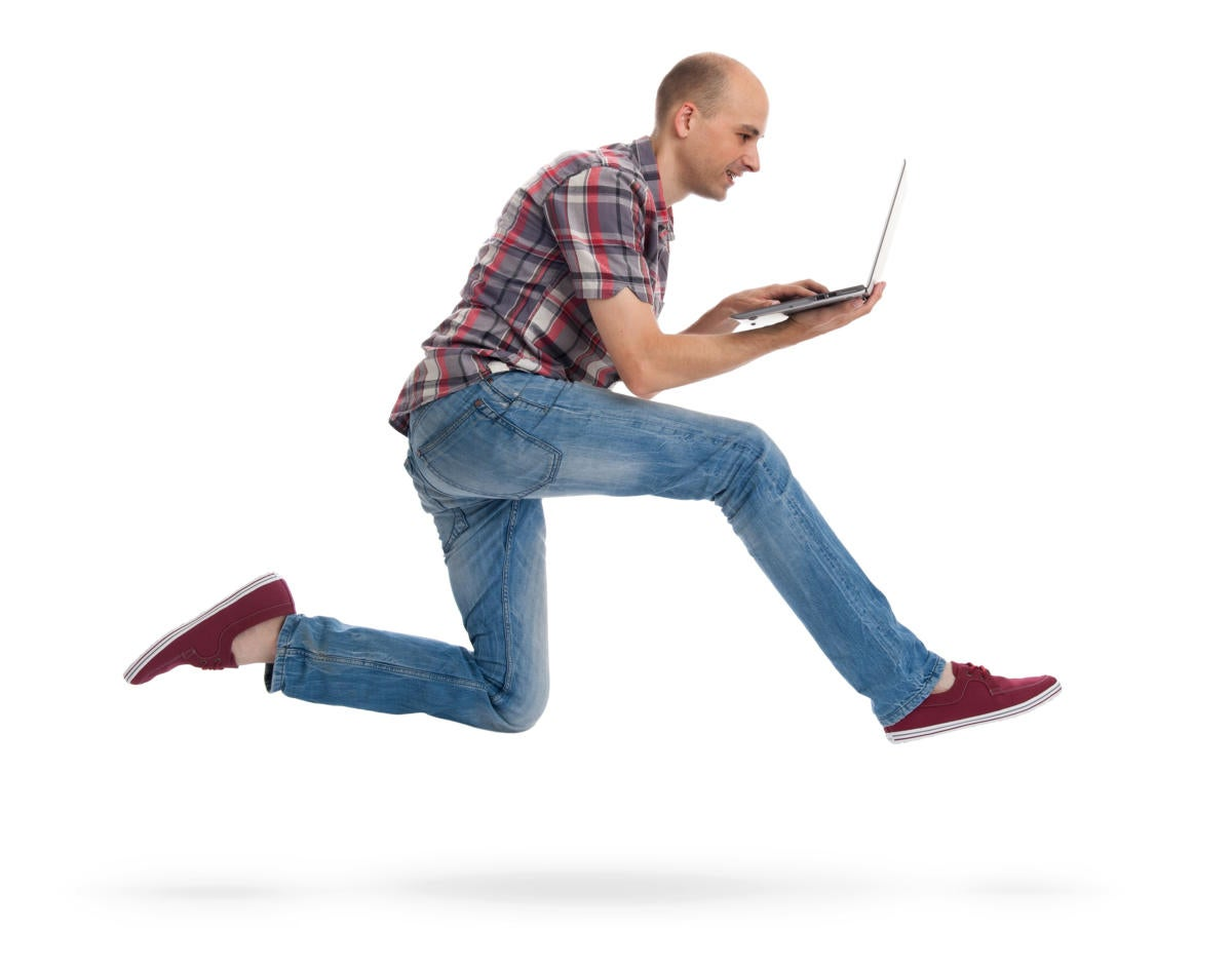 hipster running with laptop