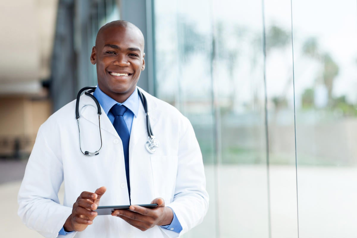 Doctor with mobile device