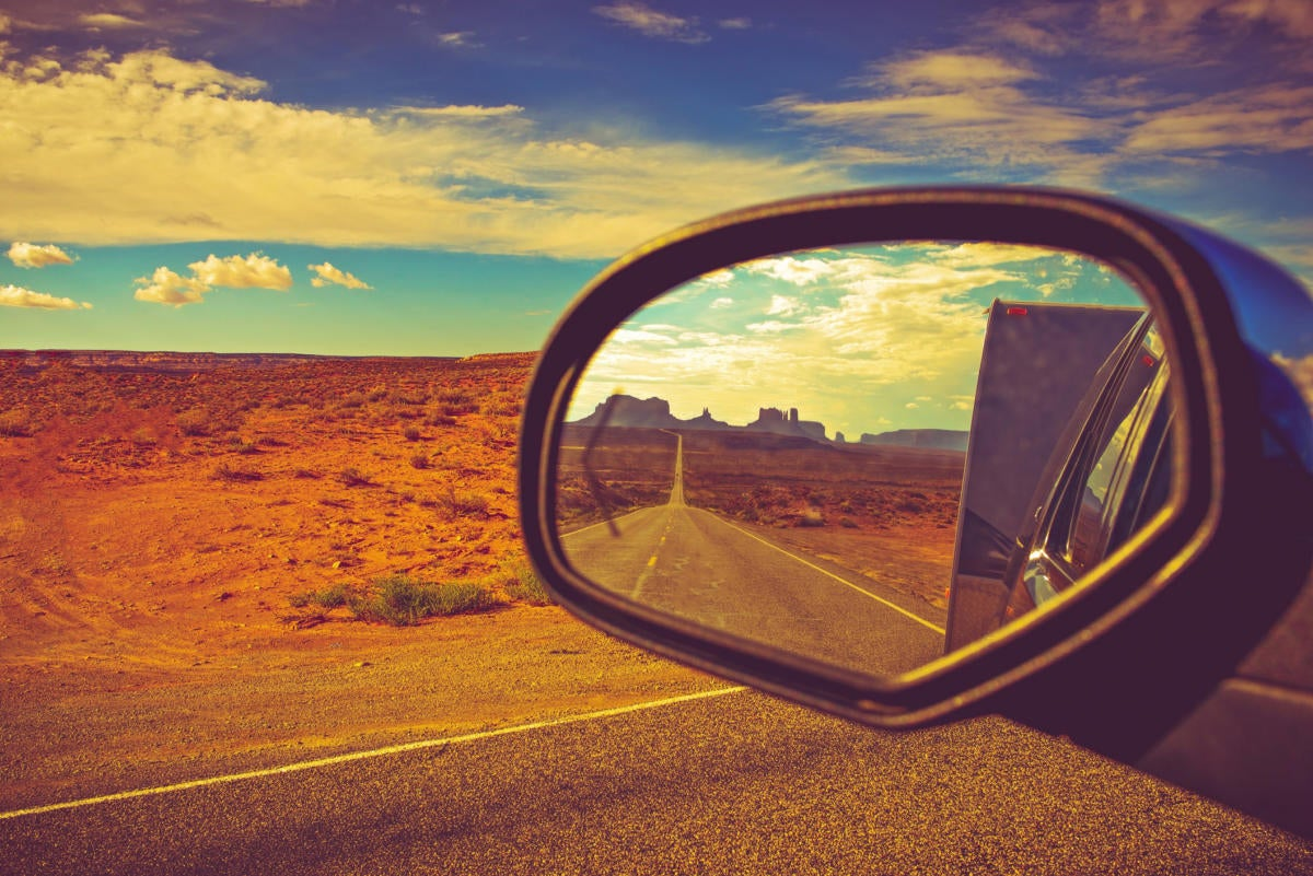 rear view mirror with desert scene in the distance
