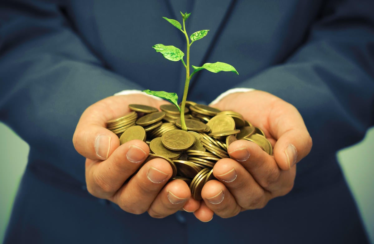 man holding money with growth