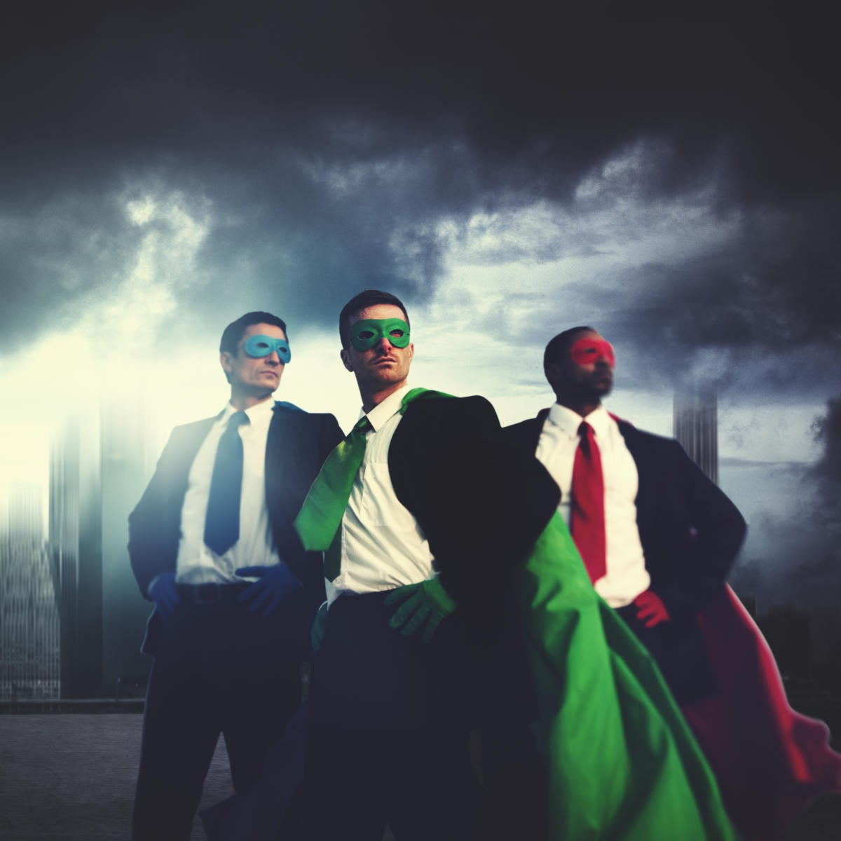 3 colorful superhero executives against cloudy sky