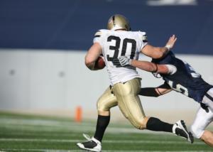 stiff arm football tackle game athlete